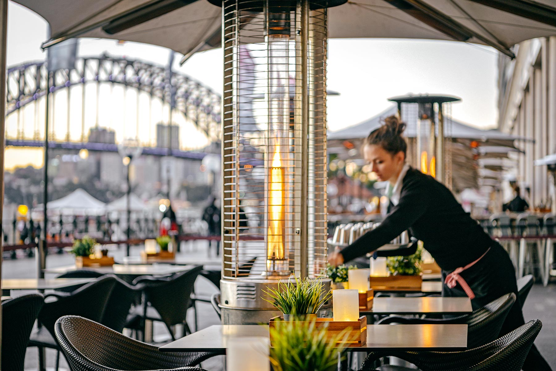 Eastbank Cafe Restaurant – waitress setting table on Circular Quay promenade